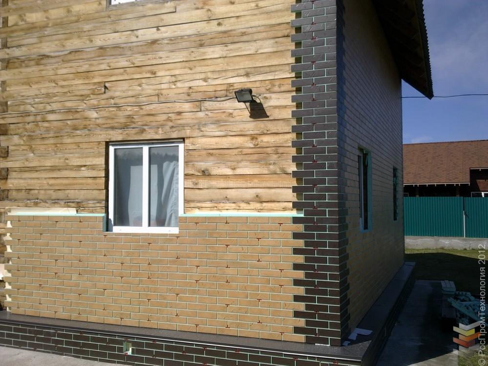 Брусовой дом: облицовка термопанелями под кирпич