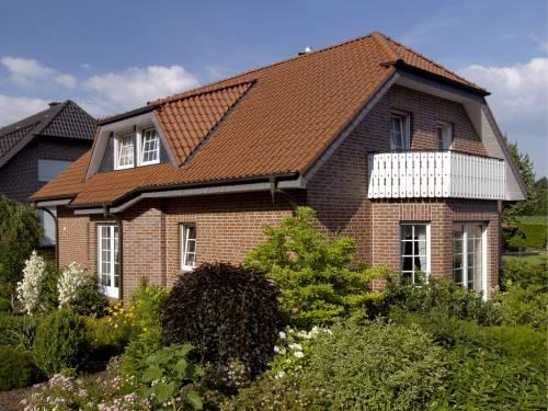 Так будет выглядеть каркасный дом после облицовки кирпичом