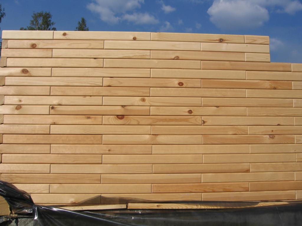 Возведение стены из деревянного блок-кирпича