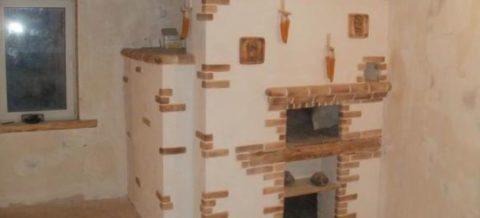 Оштукатуренный очаг можно покрасить или побелить и отделать клинкерной плиткой