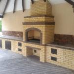 Кирпичная печь под крышей – комфорт и защита конструкции от осадков