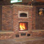 Можно заводскую печь-камин обложить кирпичом